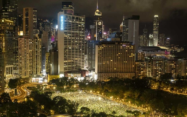 Defying a ban, people gathered in Hong Kong's Victoria Park and other locations on Thursday, Jun 4, 2020, to observe the annual vigil for victims of the Tiananmen killings. The New York Times