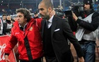 FILE PHOTO: Almeria's coach Juanma Lillo (L) and Barcelona's coach Josep Guardiola leave the pitch at the end of their Spanish first division soccer match at Juegos Mediterraneos stadium in Almeria, November 20, 2010. REUTERS