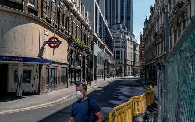 FILE -- A man wears a protective face mask in London on May 8, 2020. A no-deal Brexit would disrupt the British economy, but some argue that the shock would be washed away in the upheaval of the pandemic. (Andrew Testa/The New York Times)