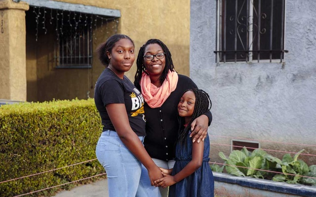 Danielle Gandy with her daughters Madison, 15, and Cadynce, 6, in Los Angeles on May 30, 2020. The abrupt switch to remote learning wiped out academic gains for many students in America, and widened racial and economic gaps. (Kendrick Brinson/The New York Times)