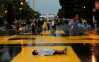 Rukiya Ahmed and Yoreanos Alemu lie on the street as a protest against the death in Minneapolis police custody of George Floyd, in Washington, US, June 5, 2020. Reuters