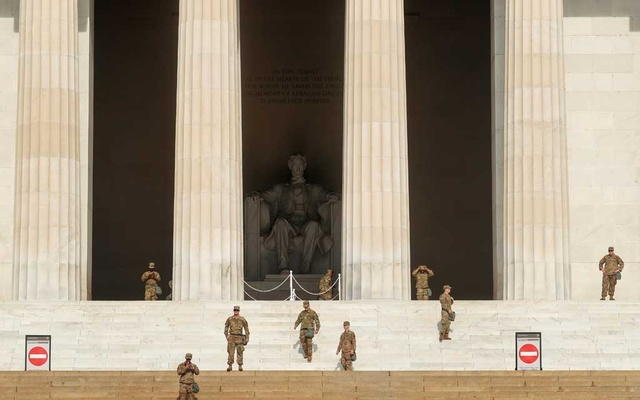 Soldiers stand near the Lincoln Memorial ahead of a protest against racial inequality in the aftermath of the death in Minneapolis police custody of George Floyd, in Washington, US June 6, 2020. Reuters