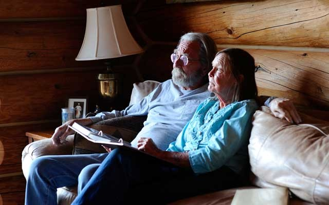 Wendell and Mariann Hardy look through a photo album at their home in Catron County, New Mexico, US, Apr 28 2020. REUTERS