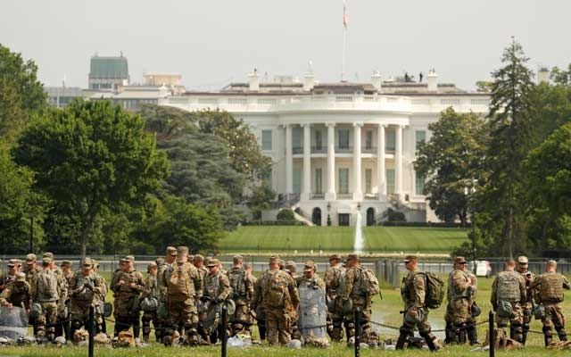 Uniformed military personnel stands in front of the White House ahead of a protest against racial inequality in the aftermath of the death in Minneapolis police custody of George Floyd, in Washington, US June 6, 2020. Reuters