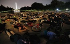 Demonstrators lie down during a protest against racial inequality in the aftermath of the death in Minneapolis police custody of George Floyd at the Lincoln Memorial in Washington, US, June 6, 2020. REUTERS