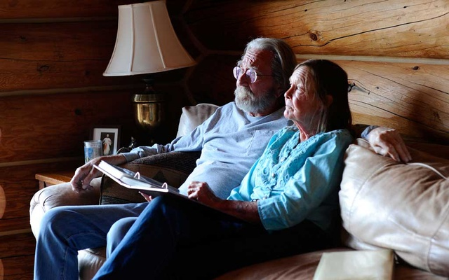 Wendell and Mariann Hardy look through a photo album at their home in Catron County, New Mexico, US, April 28 2020. REUTERS