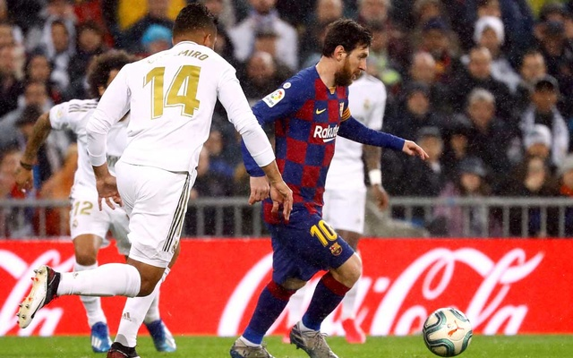 March 1, 2020 Barcelona's Lionel Messi in action with Real Madrid's Casemiro REUTERS/Juan Medina/File Photo