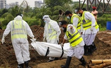 Volunteers performing the last rites of a patient who died from COVID-19 at Rayer Bazar graveyard. Photo: Mahmud Zaman Ovi