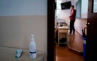 A thermometre and a sanitising gel are seen outside a classroom during a government-organised media tour at a high school as more students returned to campus following the coronavirus disease (COVID-19) outbreak, in Shanghai, China May 7, 2020.