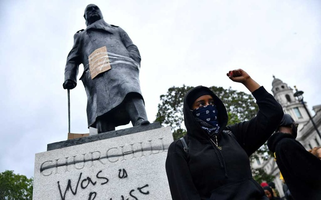 FILE PHOTO: A demonstrator reacts infront of graffiti on a statue of Winston Churchill in Parliament Square during a Black Lives Matter protest in London, following the death of George Floyd who died in police custody in Minneapolis, London, Britain, June 7, 2020. REUTERS