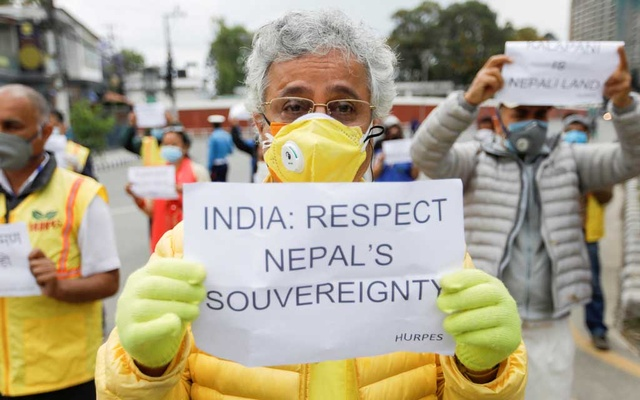 FILE PHOTO: Activists affiliated with 'Human Rights and Peace Society Nepal' holding placards protest against the alleged encroachment of Nepal's border by India in the far west of Nepal, near the Indian Embassy in Kathmandu, Nepal May 12, 2020. Reuters