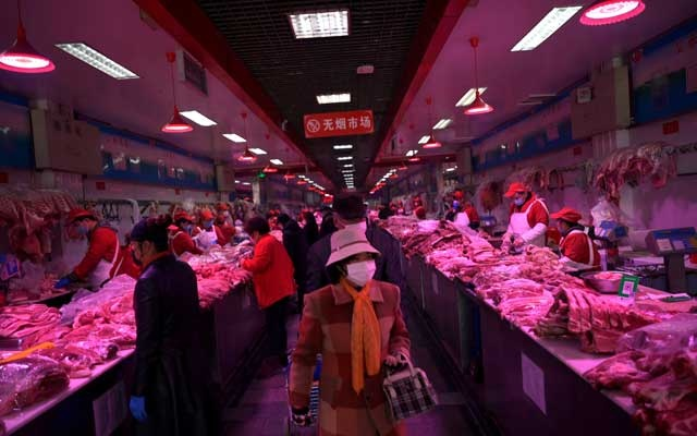 Beijing reports new Covid-19 cases linked to food market