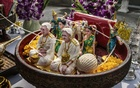 Figurines representing the ancestors of the landowners of the Baan Pitak condominium complex at the consecration ceremony of the complex' spirit house in Bangkok, May 18, 2020. The New York Times