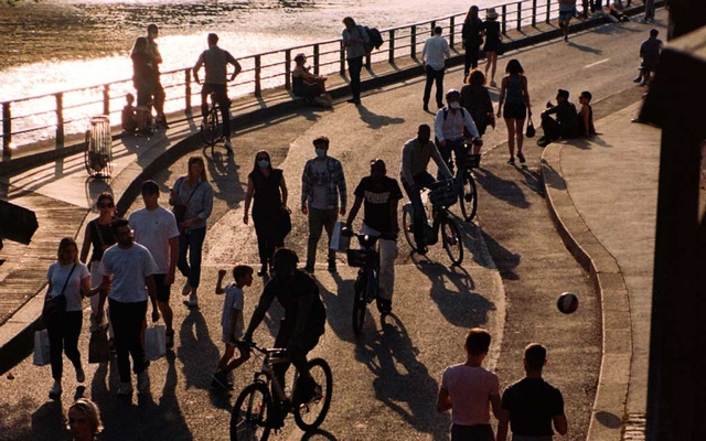 Bicyclists and pedestrians mix on a pathway along the Seine in Paris on May 19, 2020. The New York Times