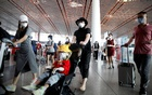 Travellers wearing protective gear are seen at the departure hall of Beijing Capital International Airport after scores of domestic flights in and out of the Chinese capital were cancelled following the new outbreak of the coronavirus disease (COVID-19) in Beijing, China Jun 17, 2020. REUTERS