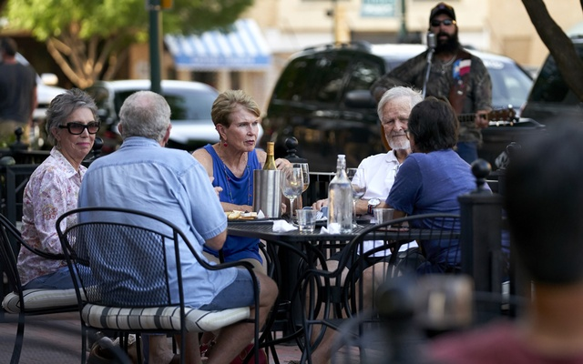 Diners sit street-side at Landon Winery in McKinney, Texas, May 22, 2020. The New York Times