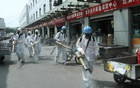FILE PHOTO: Volunteers from Blue Sky Rescue team in protective suits disinfect the Yuegezhuang wholesale market, following new cases of coronavirus disease (COVID-19) infections in Beijing, China June 16, 2020. China Daily via REUTERS
