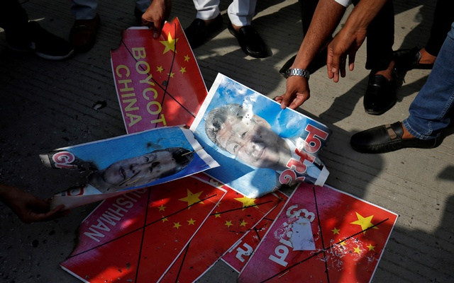 Members of National Students' Union of India (NSUI) burn posters of Chinese President Xi Jinping during a protest against China, in Ahmedabad, India, Jun 18, 2020. REUTERS