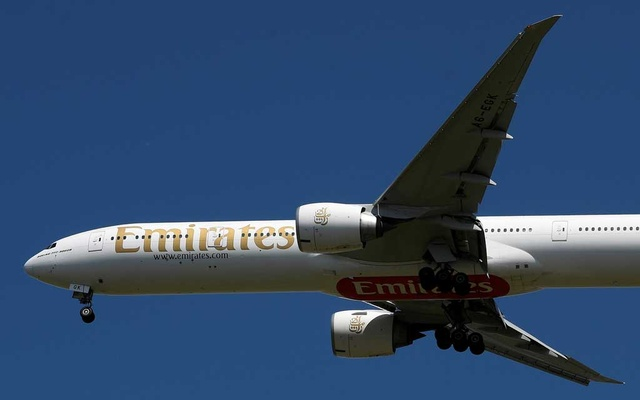 An Emirates passenger plane comes in to land at Heathrow airport during the coronavirus pandemic, London, Britain, May 21, 2020. REUTERS