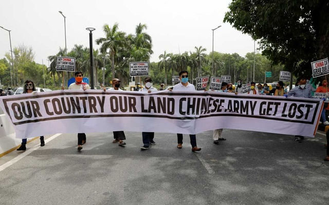 Demonstrators hold a banner during a protest against China, in New Delhi, India, on June 19. REUTERS