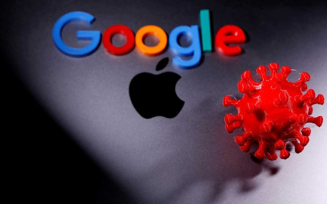3D printed coronavirus model and Google logo are placed near an Apple Macbook Pro in this illustration taken April 12, 2020. REUTERS