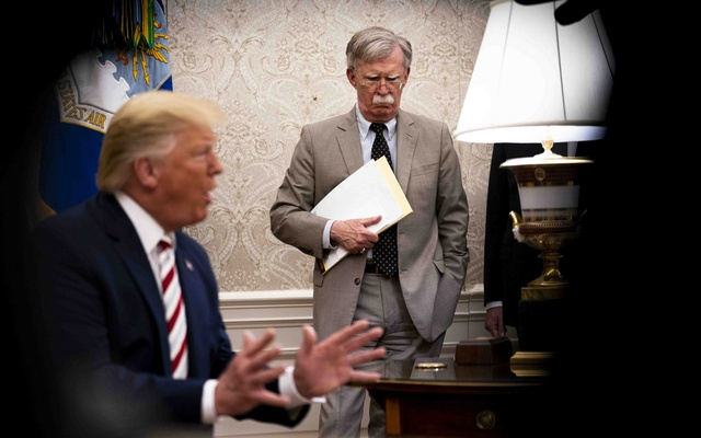 John Bolton as President Donald Trump meets with Klaus Iohannis, the president of Romania, in the Oval Office of the White House in Washington, Aug  20, 2019. The New York Times