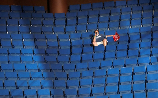 A supporter of US President Donald Trump shoots a video with his mobile phone from the sparsely filled upper decks of the arena as the president addresses his first re-election campaign rally in several months in the midst of the coronavirus disease (COVID-19) outbreak, at the BOK Centre in Tulsa, Oklahoma, US, June 20, 2020. REUTERS