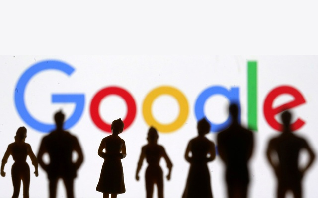 Small toy figures are seen in front of Google logo in this illustration picture, April 8, 2019. REUTERS