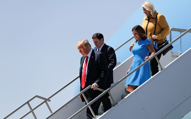 US President Donald Trump walks down the steps of Air Force One with Arizona Governor Doug Ducey, US Senator Martha McSally (R-AZ) and US Rep Debbie Lesko (R-AZ) as he arrives at Phoenix Sky Harbor International Airport in Phoenix, Arizona, US, Jun 23, 2020. REUTERS