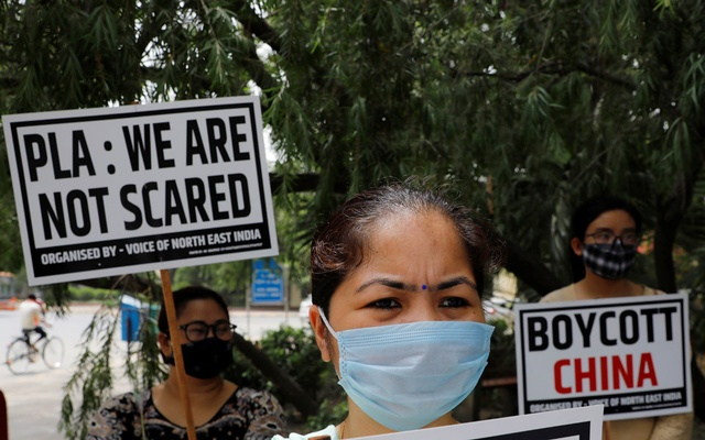 Demonstrators hold placards during a protest against China, in New Delhi, India, Jun 19, 2020. REUTERS