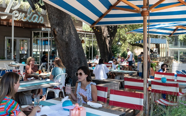 IPeople at a restaurant that socially distanced customers on patios in Austin, Texas, June 17, 2020. The New York Times