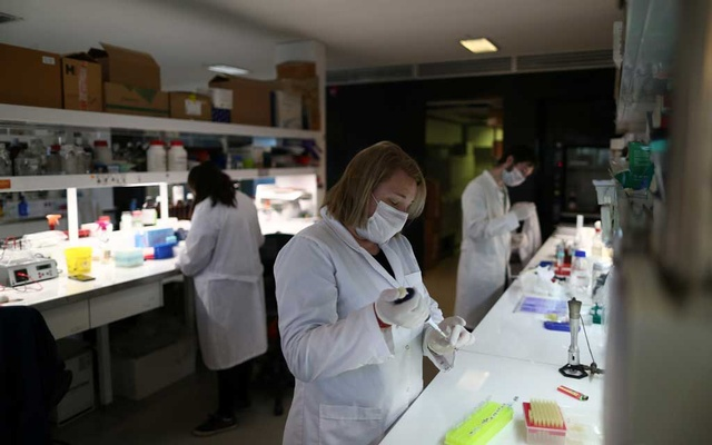 Laboratory technician Laura Bruno works in a project to find a vaccine for the coronavirus disease (COVID-19), in a lab, in Buenos Aires, Argentina Jun 18, 2020. REUTERS