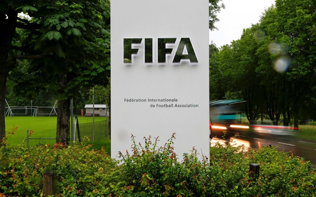 Cars drive past a logo in front of FIFA's headquarters in Zurich, Switzerland June 8, 2016. REUTERS