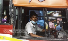 Bus drivers and their aides flout health measures despite a surge in coronavirus cases and deaths. The transport shutdown ended more than a month ago, allowing vehicles to resume services amid contagion risks. Photo: Mahmud Zaman Ovi