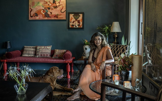 Divya Thakur with her dog Trooper at home in Mumbai, India, Jun 13, 2020. Thakur, founder of the 21-year-old boutique shop Design Temple, and more recently the nonprofit Museum of Design, has conducted a long-running crusade to gain recognition and respect for India's visual design tradition. Atul Loke/The New York Times
