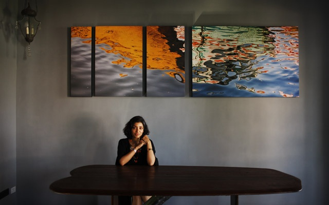 Divya Thakur sits at a table she designed at her home in Mumbai, India, Nov 19, 2009. Michael Rubenstein/The New York Times