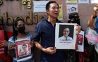 People hold placards depicting abducted Thai activist Wanchalearm Satsaksit during a protest calling for an investigation, in front of the Cambodian embassy in Bangkok, Thailand, June 8, 2020. REUTERS/Jorge Silva