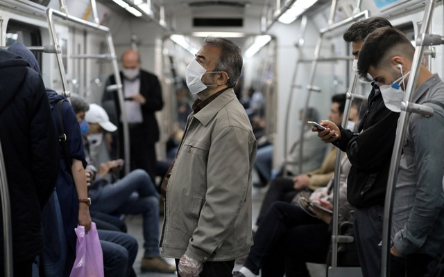 FILE PHOTO: Iranians wear protective face masks, following the outbreak of the coronavirus disease (COVID-19), as they drive with the metro, in Tehran, Iran, May 20, 2020. WANA (West Asia News Agency)/Ali Khara via REUTERS