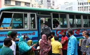 People huddle to get on a bus after the government has eased restrictions on public transport amid concerns over the coronavirus disease (COVID-19) outbreak in Dhaka, Bangladesh, June 4, 2020. REUTERSLockdowns tamed road traffic