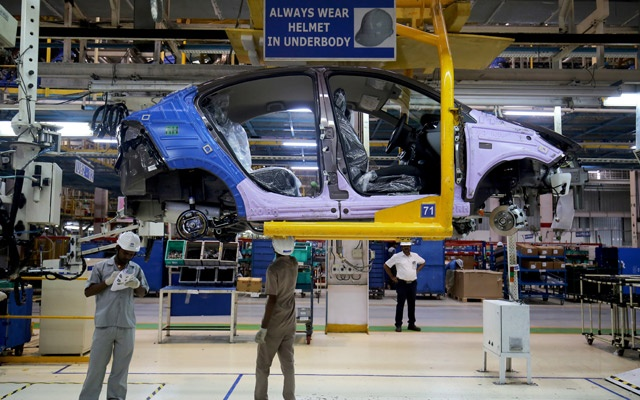 Workers assemble a Tata Tigor car inside the Tata Motors car plant in Sanand, on the outskirts of Ahmedabad, India, August 7, 2018. Reuters