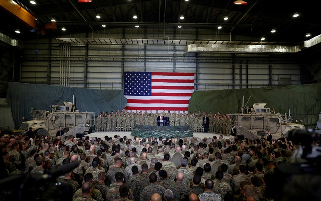 FILE PHOTO: US President Donald Trump delivers remarks to US troops during an unannounced visit to Bagram Air Base, Afghanistan, November 28, 2019. REUTERS/Tom Brenner/File Photo