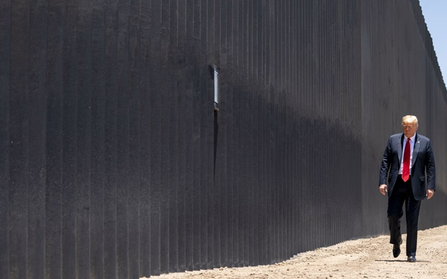 President Donald Trump walks along the border wall in San Luis, Ariz, Jun 23, 2020. A federal appeals court in San Francisco ruled on Friday that the Trump administration did not have the authority to transfer $2.5 billion from the Pentagon to President Trump's border wall without congressional approval, likely sending the matter to the Supreme Court. Doug Mills/The New York Times