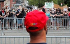 A demonstrator wearing a Trump hat looks at counter-protestors during a pro-police rally, following protests against racial inequality in the aftermath of the death in Minneapolis police custody of George Floyd, in Boston, Massachusetts, US, June 27, 2020. Reuters