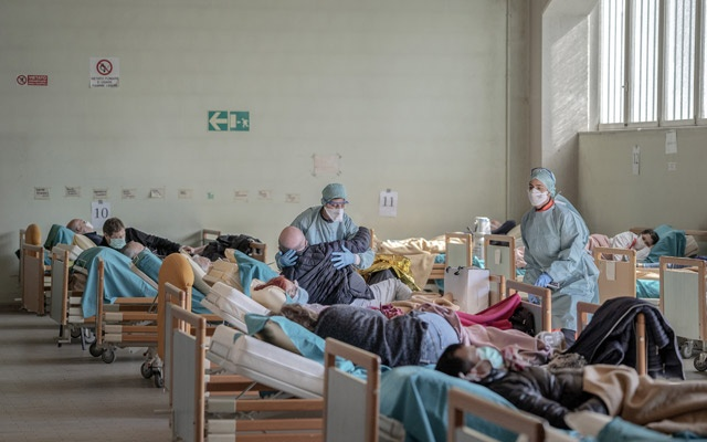 Health care workers tend to patients awaiting test results at a hospital in Brescia, Italy, Mar 16, 2020. Alessandro Grassani/The New York Times