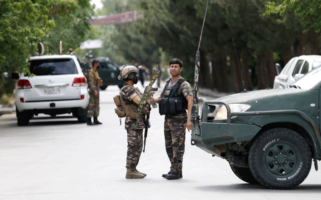 Afghan security forces stand guard near the site of an attack in Kabul, Afghanistan Jun 12, 2020.REUTERS/FILE
