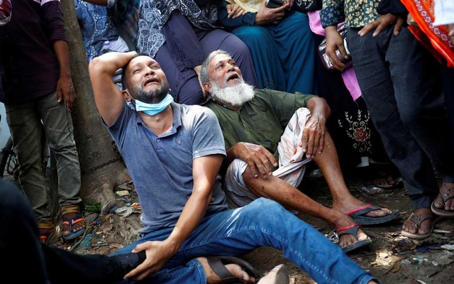 Relatives of victims mourn after a passenger ferry capsized in the river Buriganga in Dhaka on Jun 29. REUTERS