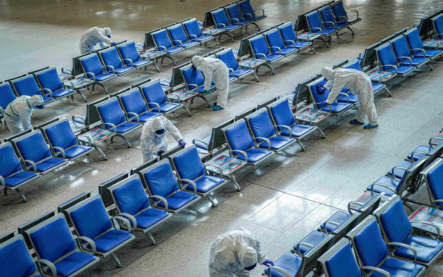Workers in protective suits disinfect a waiting hall at the Wuhan Railway Station which has been closed due to the novel coronavirus disease (COVID-19) outbreak, in Wuhan, Hubei province, China Mar 24, 2020. REUTERS