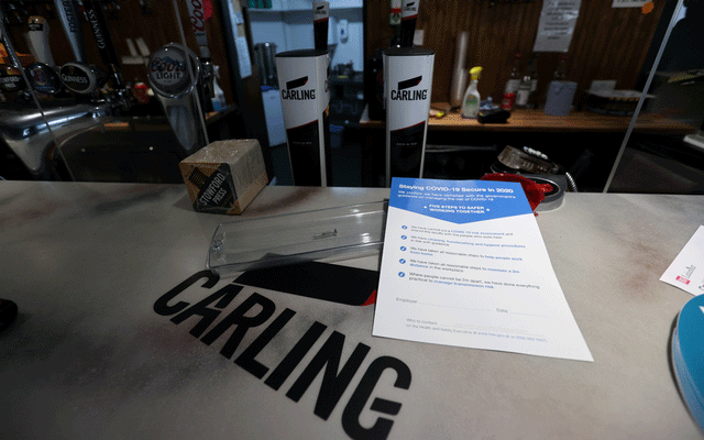 A sign informing about safety measures is seen at a pub, amid the coronavirus disease (COVID-19) outbreak, in Leicester, Britain, Jun 29, 2020. REUTERS