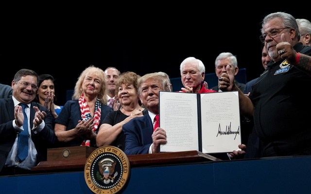 """FILE -- President Donald Trump during an executive order signing at The Villages in Florida, Oct. 3, 2019. President Trump on June 28 retweeted a video of one of his supporters yelling """"White power!,"""" once again using the vast reach of his social media platforms to inflame racial divisions in a nation roiled by weeks of protests about police brutality against black people and demands for social justice reforms. (Anna Moneymaker/The New York Times)"""