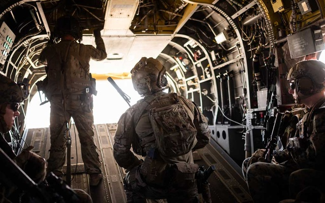 FILE -- Members of the American military in a helicopter over Helmand province, Afghanistan, Sept. 26, 2019. United States intelligence officers and Special Operations forces in Afghanistan alerted their superiors as early as January to a suspected Russian plot to pay bounties to the Taliban to kill American troops in Afghanistan, according to officials briefed on the matter. (Jim Huylebroek/The New York Times)